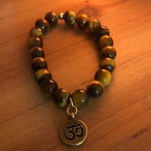 Jewelry - Tigers eyes 10 mm Bead Bracelet with Om Charm